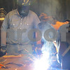 Nolan Hansen, a junior at Kishwaukee College, welds in front of local high school students Friday as part of the annual Heavy Metal Tour, which educates students on manufacturing opportunities.
