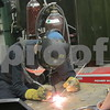 Drew Zimmerman – dzimmerman@shawmedia.com<br /> Mitchel Meares, a freshman at Kishwaukee College, performs welding in front of local high school students as part of the annual Heavy Metal Tour, which educates students on manufacturing opportunities.