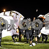 Sam Buckner for Shaw Media.<br /> Jacob Peloquin runs through a banner leading the Spartans before the homecoming game against Kaneland on Friday September 30, 2016.