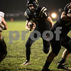 Sam Buckner for Shaw Media.<br /> Ty Sulaver runs a quarterback keeper against Kaneland on Friday September 30, 2016.