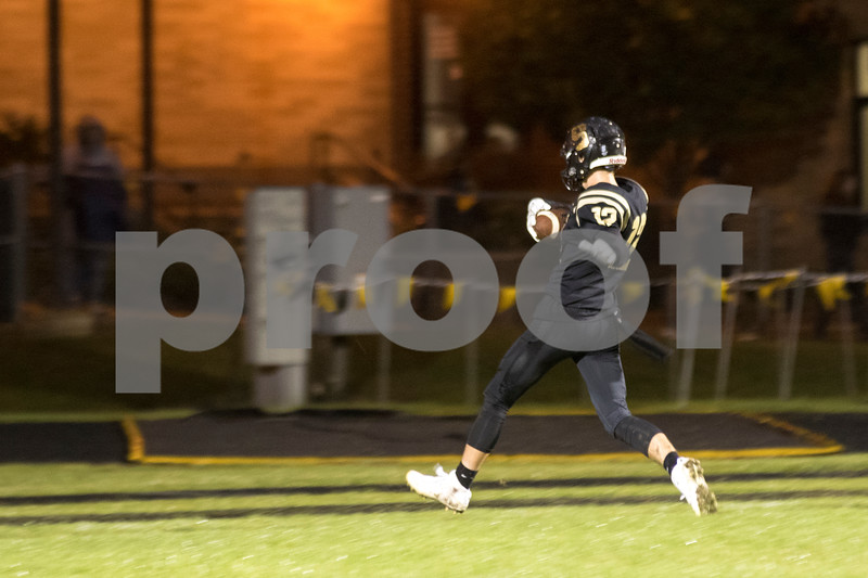 Sam Buckner for Shaw Media.<br /> Robert Cole runs the ball into the endzone in the first half against Kaneland on Friday September 30, 2016.