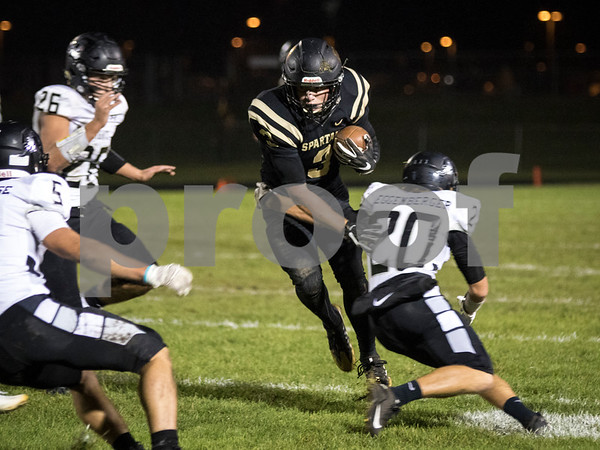 Sam Buckner for Shaw Media.<br /> Christian Pawola runs the ball through Kaneland defenders on Friday September 30, 2016.