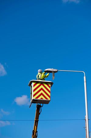 Fixing lamp post, London, United Kingdom