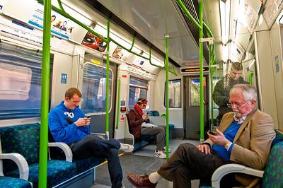 Commuters on Distric line train, London, United Kingdom