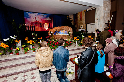 People praying in the church during Easter celebrations, Poland
