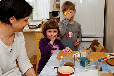 Mother with her children in a kitchen, Poland