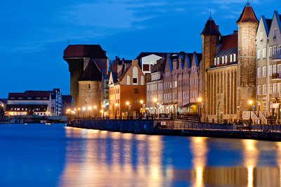 View of Old Town architecture by Motlawa River at night, Gdansk, Poland