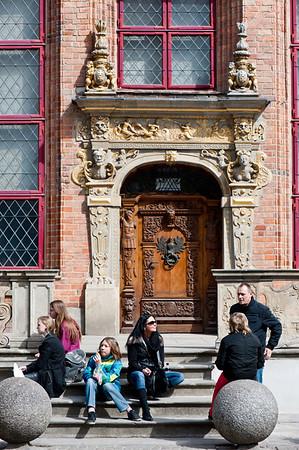 Tourists resting on steps, Gdansk, Poland