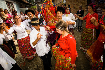 Europe, Romania, Transylvania, Gypsy wedding,  teenage bride and groom dance surrounded bywedding guests