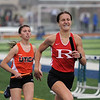 Hannah Toner of Romeo comes in first for her team in the 4x800 relay. (MIPrepZone photo gallery by David Dalton)