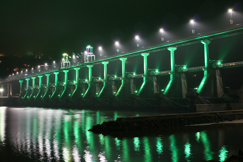"Design elements, such as L.E.D. lighting on the bridge's piers, towers, and walkway, make the bridge a good combination of function and form.   The <a href=""http://www.bigdambridge.com/"">Big Dam Bridge</a> in Pulaski County, Arkansas connects Rebsamen Park in Little Rock with Cooks Landing Park in North Little Rock. This extraordinary piece of infrastructure is nearly one mile in length and was constructed by drilling into the top of the Murray Lock and Dam on the Arkansas River. The bridge is an integral portion of the Millennium Trail, a collection of riverside trails along both sides of the Arkansas River that, when completed, will create a 15-mile multi-use bike path. The bridge's exemplary design elements, which include L.E.D. lighting and generous 14-foot right-of-way, have resulted in twelve awards from a number of professional associations and societies. The bridge opened September 30, 2006.  Federal TE funding amounting to $300,000 was awarded to the project leveraging a local match of over $11 million.  Photo by Steve Morgan."