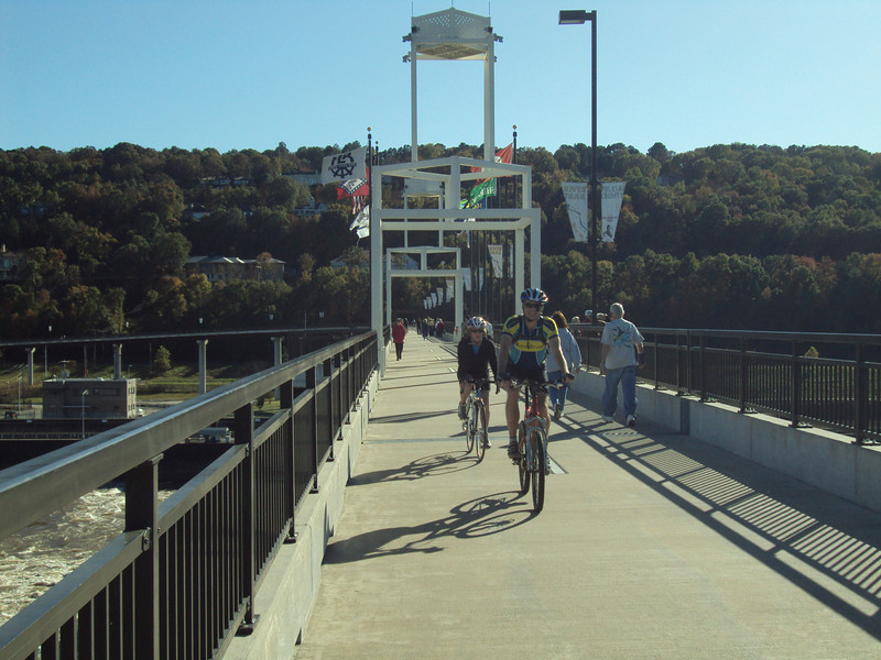 "In addition to general recreation use, the Big Dam Bridge is the site of nearly a dozen walking and biking events throughout the spring and summer.   The <a href=""http://www.bigdambridge.com/"">Big Dam Bridge</a> in Pulaski County, Arkansas connects Rebsamen Park in Little Rock with Cooks Landing Park in North Little Rock. This extraordinary piece of infrastructure is nearly one mile in length and was constructed by drilling into the top of the Murray Lock and Dam on the Arkansas River. The bridge is an integral portion of the Millennium Trail, a collection of riverside trails along both sides of the Arkansas River that, when completed, will create a 15-mile multi-use bike path. The bridge's exemplary design elements, which include L.E.D. lighting and generous 14-foot right-of-way, have resulted in twelve awards from a number of professional associations and societies. The bridge opened September 30, 2006.  Federal TE funding amounting to $300,000 was awarded to the project leveraging a local match of over $11 million."