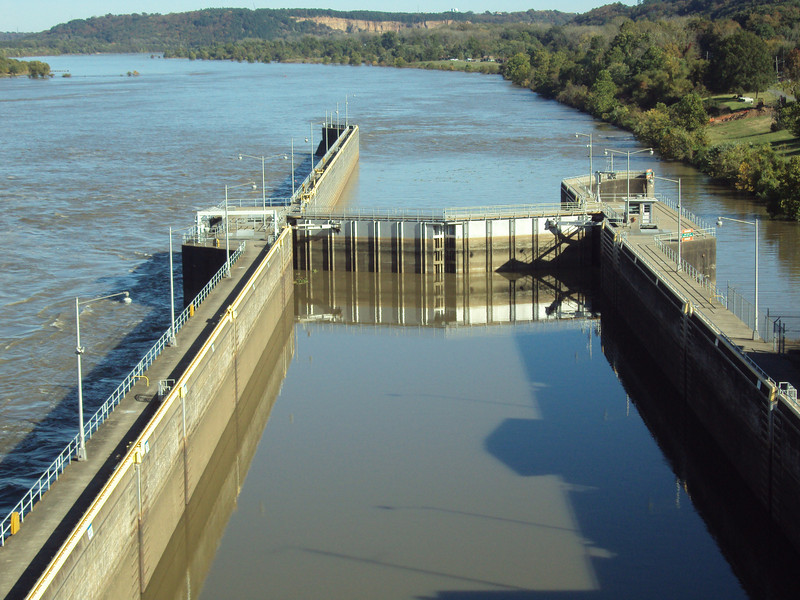 """The Murray Lock and Dam was built in 1969 by the Army Corps of Engineers for navigational purposes. It remains operational today.  The <a href=""""http://www.bigdambridge.com/"""">Big Dam Bridge</a> in Pulaski County, Arkansas connects Rebsamen Park in Little Rock with Cooks Landing Park in North Little Rock. This extraordinary piece of infrastructure is nearly one mile in length and was constructed by drilling into the top of the Murray Lock and Dam on the Arkansas River. The bridge is an integral portion of the Millennium Trail, a collection of riverside trails along both sides of the Arkansas River that, when completed, will create a 15-mile multi-use bike path. The bridge's exemplary design elements, which include L.E.D. lighting and generous 14-foot right-of-way, have resulted in twelve awards from a number of professional associations and societies. The bridge opened September 30, 2006.  Federal TE funding amounting to $300,000 was awarded to the project leveraging a local match of over $11 million."""