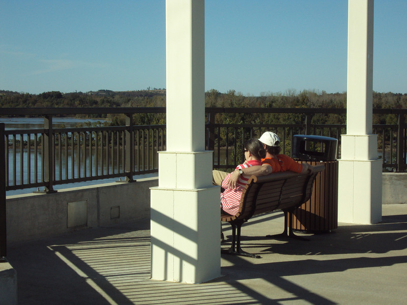 "There are eight observation areas along the bridge. Trash receptacles help to keep the bridge free of trash during major events.  The <a href=""http://www.bigdambridge.com/"">Big Dam Bridge</a> in Pulaski County, Arkansas connects Rebsamen Park in Little Rock with Cooks Landing Park in North Little Rock. This extraordinary piece of infrastructure is nearly one mile in length and was constructed by drilling into the top of the Murray Lock and Dam on the Arkansas River. The bridge is an integral portion of the Millennium Trail, a collection of riverside trails along both sides of the Arkansas River that, when completed, will create a 15-mile multi-use bike path. The bridge's exemplary design elements, which include L.E.D. lighting and generous 14-foot right-of-way, have resulted in twelve awards from a number of professional associations and societies. The bridge opened September 30, 2006.  Federal TE funding amounting to $300,000 was awarded to the project leveraging a local match of over $11 million."