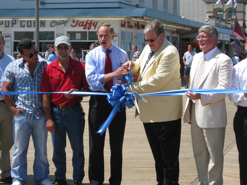 Senator Thomas Carper (D-DE), the senior senator from Delaware, cuts the ribbon with Rehoboth Beach mayor Samuel Cooper.