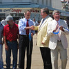Senator Carper and Mayor Cooper shake hands as Stan Mills (right), Rehoboth Beach Commissioner and Boardwalk Committee chair, holds the ribbon.