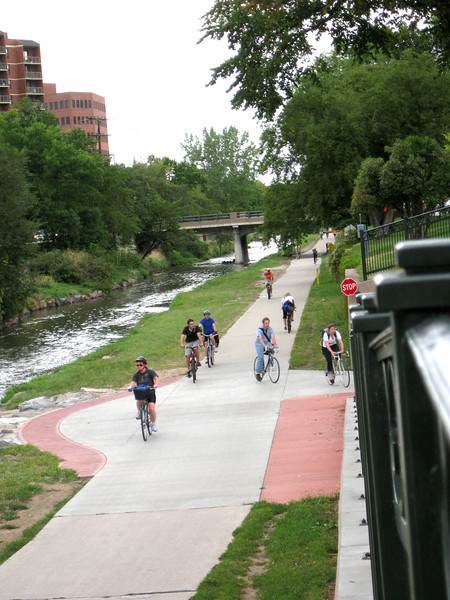 The trail is a greenway constructed in the path of Cherry Creek.  Bicycle commuters enjoy a scenic, but speedy, route home from work.<br /> <br /> The Cherry Creek Trail runs from downtown Denver for more than 40 miles, connecting multiple suburbs and counties to the heart of the city.  The trail is below grade for much of the way, following the bed of the creek.  This minimizes the number of road crossings, and thus reduces conflicts between cars and nonmotorized travelers.  Residences, jobs, schools, parks, and shopping are all seamlessly connected on the trail corridor.<br /> <br /> The trail is a regional effort.  Various TE grants with differing sources of matching funds have contributed to constructing and improving the trail including $417,000 in 1999 to the City of Denver, $164,844 in 2001 to the town of Glendale, $365,000 in 2003 to Arapahoe County, and an additional $315,000 to Denver in 2005.  The end product is a trail that is one of the spines of a regional network of trails connecting travelers and destinations throughout the Denver area.