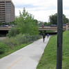 Crossings are generally accomplished via underpasses.<br /> <br /> The Cherry Creek Trail runs from downtown Denver for more than 40 miles, connecting multiple suburbs and counties to the heart of the city.  The trail is below grade for much of the way, following the bed of the creek.  This minimizes the number of road crossings, and thus reduces conflicts between cars and nonmotorized travelers.  Residences, jobs, schools, parks, and shopping are all seamlessly connected on the trail corridor.<br /> <br /> The trail is a regional effort.  Various TE grants with differing sources of matching funds have contributed to constructing and improving the trail including $417,000 in 1999 to the City of Denver, $164,844 in 2001 to the town of Glendale, $365,000 in 2003 to Arapahoe County, and an additional $315,000 to Denver in 2005.  The end product is a trail that is one of the spines of a regional network of trails connecting travelers and destinations throughout the Denver area.
