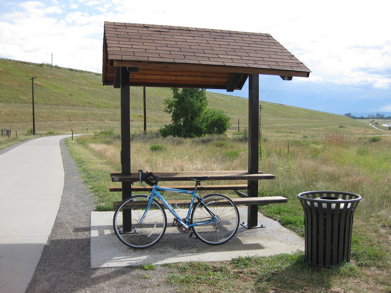 A rest stop on the Cherry Creek Dam Trail.<br /> <br /> The Cherry Creek Trail runs from downtown Denver for more than 40 miles, connecting multiple suburbs and counties to the heart of the city.  The trail is below grade for much of the way, following the bed of the creek.  This minimizes the number of road crossings, and thus reduces conflicts between cars and nonmotorized travelers.  Residences, jobs, schools, parks, and shopping are all seamlessly connected on the trail corridor.<br /> <br /> The trail is a regional effort.  Various TE grants with differing sources of matching funds have contributed to constructing and improving the trail including $417,000 in 1999 to the City of Denver, $164,844 in 2001 to the town of Glendale, $365,000 in 2003 to Arapahoe County, and an additional $315,000 to Denver in 2005.  The end product is a trail that is one of the spines of a regional network of trails connecting travelers and destinations throughout the Denver area.
