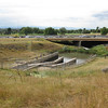A view of the Cherry Creek Dam, at the intersection between the two trails.<br /> <br /> The Cherry Creek Trail runs from downtown Denver for more than 40 miles, connecting multiple suburbs and counties to the heart of the city.  The trail is below grade for much of the way, following the bed of the creek.  This minimizes the number of road crossings, and thus reduces conflicts between cars and nonmotorized travelers.  Residences, jobs, schools, parks, and shopping are all seamlessly connected on the trail corridor.<br /> <br /> The trail is a regional effort.  Various TE grants with differing sources of matching funds have contributed to constructing and improving the trail including $417,000 in 1999 to the City of Denver, $164,844 in 2001 to the town of Glendale, $365,000 in 2003 to Arapahoe County, and an additional $315,000 to Denver in 2005.  The end product is a trail that is one of the spines of a regional network of trails connecting travelers and destinations throughout the Denver area.