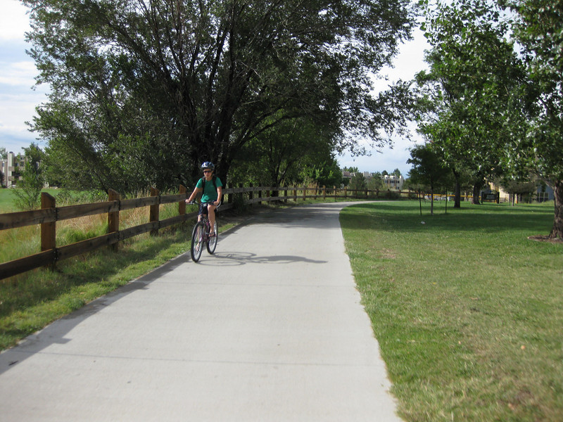 In Arapahoe County, the trail returns to grade and provides scenic views.<br /> <br /> The Cherry Creek Trail runs from downtown Denver for more than 40 miles, connecting multiple suburbs and counties to the heart of the city.  The trail is below grade for much of the way, following the bed of the creek.  This minimizes the number of road crossings, and thus reduces conflicts between cars and nonmotorized travelers.  Residences, jobs, schools, parks, and shopping are all seamlessly connected on the trail corridor.<br /> <br /> The trail is a regional effort.  Various TE grants with differing sources of matching funds have contributed to constructing and improving the trail including $417,000 in 1999 to the City of Denver, $164,844 in 2001 to the town of Glendale, $365,000 in 2003 to Arapahoe County, and an additional $315,000 to Denver in 2005.  The end product is a trail that is one of the spines of a regional network of trails connecting travelers and destinations throughout the Denver area.