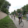 On an August day around 6 pm In downtown Denver, the trail is filled with riders during the evening rush hour.<br /> <br /> The Cherry Creek Trail runs from downtown Denver for more than 40 miles, connecting multiple suburbs and counties to the heart of the city.  The trail is below grade for much of the way, following the bed of the creek.  This minimizes the number of road crossings, and thus reduces conflicts between cars and nonmotorized travelers.  Residences, jobs, schools, parks, and shopping are all seamlessly connected on the trail corridor.<br /> <br /> The trail is a regional effort.  Various TE grants with differing sources of matching funds have contributed to constructing and improving the trail including $417,000 in 1999 to the City of Denver, $164,844 in 2001 to the town of Glendale, $365,000 in 2003 to Arapahoe County, and an additional $315,000 to Denver in 2005.  The end product is a trail that is one of the spines of a regional network of trails connecting travelers and destinations throughout the Denver area.