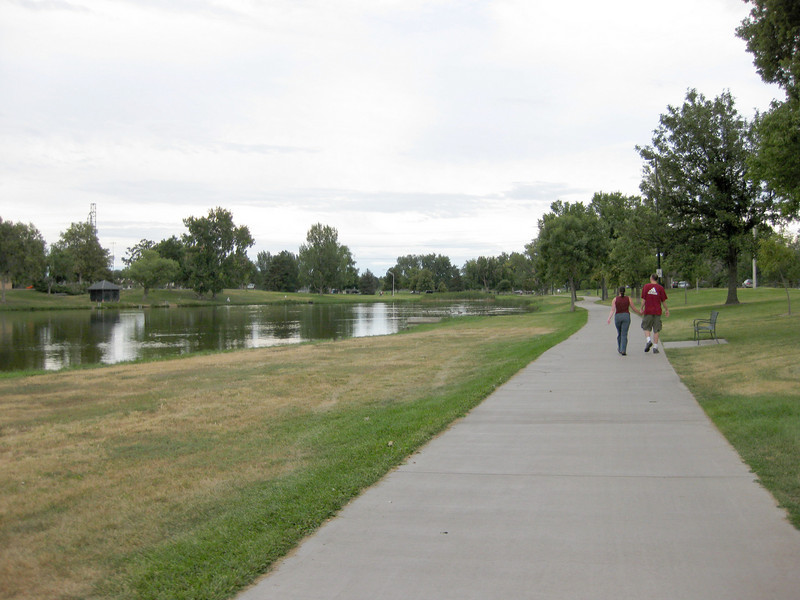 The trail runs through Garland Park.<br /> <br /> The Cherry Creek Trail runs from downtown Denver for more than 40 miles, connecting multiple suburbs and counties to the heart of the city.  The trail is below grade for much of the way, following the bed of the creek.  This minimizes the number of road crossings, and thus reduces conflicts between cars and nonmotorized travelers.  Residences, jobs, schools, parks, and shopping are all seamlessly connected on the trail corridor.<br /> <br /> The trail is a regional effort.  Various TE grants with differing sources of matching funds have contributed to constructing and improving the trail including $417,000 in 1999 to the City of Denver, $164,844 in 2001 to the town of Glendale, $365,000 in 2003 to Arapahoe County, and an additional $315,000 to Denver in 2005.  The end product is a trail that is one of the spines of a regional network of trails connecting travelers and destinations throughout the Denver area.
