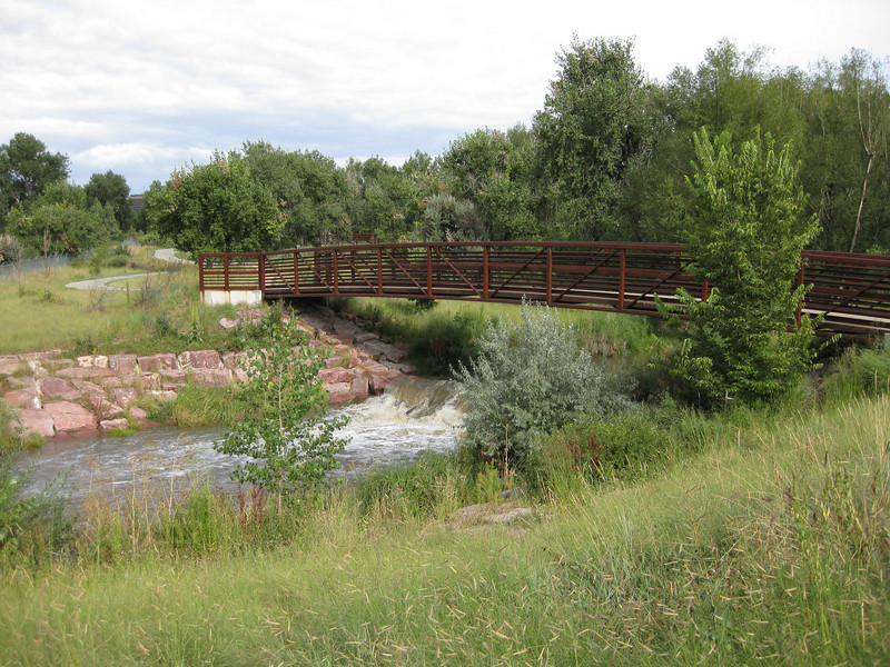 The trail crosses the creek several times on a series of bridges.<br /> <br /> The Cherry Creek Trail runs from downtown Denver for more than 40 miles, connecting multiple suburbs and counties to the heart of the city.  The trail is below grade for much of the way, following the bed of the creek.  This minimizes the number of road crossings, and thus reduces conflicts between cars and nonmotorized travelers.  Residences, jobs, schools, parks, and shopping are all seamlessly connected on the trail corridor.<br /> <br /> The trail is a regional effort.  Various TE grants with differing sources of matching funds have contributed to constructing and improving the trail including $417,000 in 1999 to the City of Denver, $164,844 in 2001 to the town of Glendale, $365,000 in 2003 to Arapahoe County, and an additional $315,000 to Denver in 2005.  The end product is a trail that is one of the spines of a regional network of trails connecting travelers and destinations throughout the Denver area.