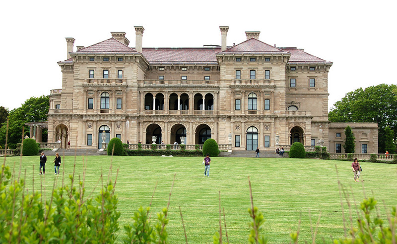 """The Breakers Mansion.<br /> <br /> The Breakers is one of many mansions along the Cliff Walk. The five-story, 70-room mansion was built as the summer home for Cornelius Vanderbilt II, who amassed his fortune from railroad and shipping empires. The mansion was constructed between 1893 and 1895, for more than $7 million (approximately $150 in today's dollars).<br /> <br /> The mansion is now owned by the Preservation Society of Newport, and is open to the public (with the exception of the third floor where members of the Vanderbilt family still reside). It is the largest mansion in Newport, and the most-visited attraction in Rhode Island. <br /> <br /> For more information about The Breakers visit <br />  <a href=""""http://tickets.newportmansions.org/mansion.aspx?id=1000"""">http://tickets.newportmansions.org/mansion.aspx?id=1000</a><br /> <br /> The 3.5-mile Cliff Walk is considered one of Newport, Rhode Island's top attractions. The scenic walkway, which runs from First Beach to Bailey's Beach, is bordered by the Rhode Island Sound and Atlantic Ocean on one side, and many of the famous seaside Newport Mansions on the other. In 1975, the Cliff Walk was designated as a National Recreation Trail. <br /> <br /> Local historians believe that the first paths along the Cliff Walk shore line were forged by deer, then by the Narragansett Indians, and later by colonial setters. Public use of the Cliff Walk was protected under the """"Fisherman's Rights"""" clause in the Colonial Charter of King Charles II, and later in the Rhode Island Constitution which grants the public the """"privileges of the shore.""""<br /> <br /> Efforts to establish the Cliff Walk began in about 1880, when a number of owners of adjacent property joined together to make improvements. Over time the property owners and the public made improvements to the path piece by piece. Portions of the Cliff Walk were badly damaged by hurricanes in 1938 and 1954. Between 1970 and 1976, the U.S Army Corps of Engineers made basic rep"""