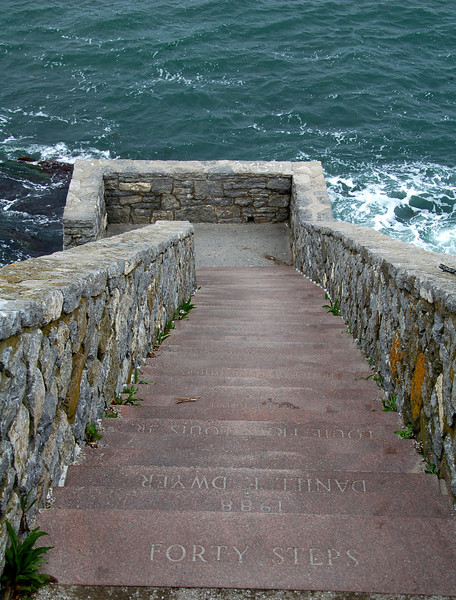 """The Forty Steps. <br /> <br /> The Forty Steps – a stone staircase that leads to down to a balcony over the sea about two-thirds down the side of the cliff. During the Gilded Age, the steps were a gathering place for the servants and workers from the nearby mansions. <br /> <br /> The 3.5-mile Cliff Walk is considered one of Newport, Rhode Island's top attractions. The scenic walkway, which runs from First Beach to Bailey's Beach, is bordered by the Rhode Island Sound and Atlantic Ocean on one side, and many of the famous seaside Newport Mansions on the other. In 1975, the Cliff Walk was designated as a National Recreation Trail. <br /> <br /> Local historians believe that the first paths along the Cliff Walk shore line were forged by deer, then by the Narragansett Indians, and later by colonial setters. Public use of the Cliff Walk was protected under the """"Fisherman's Rights"""" clause in the Colonial Charter of King Charles II, and later in the Rhode Island Constitution which grants the public the """"privileges of the shore.""""<br /> <br /> Efforts to establish the Cliff Walk began in about 1880, when a number of owners of adjacent property joined together to make improvements. Over time the property owners and the public made improvements to the path piece by piece. Portions of the Cliff Walk were badly damaged by hurricanes in 1938 and 1954. Between 1970 and 1976, the U.S Army Corps of Engineers made basic repairs to the path. <br /> <br /> Improvements continued in the early 1980s, and in 1994 TE funds were awarded (under Category 1) for further restoration that included new retaining walls to prevent erosion along the cliffs and repairs to areas damaged by Hurricane Bob in 1991. Federal Award: $1,200,000; Local Match: $300,000; Total: $1,500,000<br /> <br /> For more information on the Cliff Walk visit  <a href=""""http://www.cliffwalk.com/"""">http://www.cliffwalk.com/</a>"""