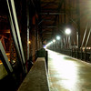 """<a href=""""http://www.flickr.com/photos/kordite/2051331168/sizes/o/in/photostream/"""">Photo Credit</a>  <b>The bridge at night.</b>  The Hot Metal Bridge in Pittsburgh, Pennsylvania was originally built in the 1880s to transport hot steel across the Monongahela River to rolling mills on the other side. This significantly improved business as steel previously had to be reheated. A century later and the bridge is now providing passage over the Monongahela River for bicyclists and pedestrians. A TE fund of over $6,500,000 was matched locally by $730,000 and went towards the removal of lead-based paint, to build a bridge over Second Ave., and to connect the bridge to the Eliza Furnace trail. The bridge reopened in November of 2007 and is a vital connection to the Pittsburgh bicycle network."""