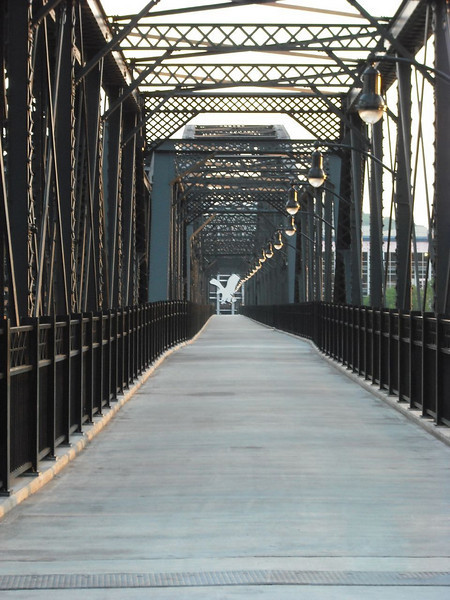 """<a href=""""http://www.flickr.com/photos/planetschwa/2560996733/sizes/o/in/photostream/"""">Photo Credit</a>  The Hot Metal Bridge in Pittsburgh, Pennsylvania was originally built in the 1880s to transport hot steel across the Monongahela River to rolling mills on the other side. This significantly improved business as steel previously had to be reheated. A century later and the bridge is now providing passage over the Monongahela River for bicyclists and pedestrians. A TE fund of over $6,500,000 was matched locally by $730,000 and went towards the removal of lead-based paint, to build a bridge over Second Ave., and to connect the bridge to the Eliza Furnace trail. The bridge reopened in November of 2007 and is a vital connection to the Pittsburgh bicycle network."""