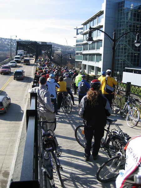 """<a href=""""http://www.flickr.com/photos/erokore/2072245400/sizes/l/in/photostream/"""">Photo Credit</a>  <b>Opening day in November of 2007.</b>  The Hot Metal Bridge in Pittsburgh, Pennsylvania was originally built in the 1880s to transport hot steel across the Monongahela River to rolling mills on the other side. This significantly improved business as steel previously had to be reheated. A century later and the bridge is now providing passage over the Monongahela River for bicyclists and pedestrians. A TE fund of over $6,500,000 was matched locally by $730,000 and went towards the removal of lead-based paint, to build a bridge over Second Ave., and to connect the bridge to the Eliza Furnace trail. The bridge reopened in November of 2007 and is a vital connection to the Pittsburgh bicycle network."""