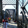 "<a href=""http://www.flickr.com/photos/kordite/2075210054/sizes/o/in/photostream/"">Photo Credit</a>  <b>Opening day in November of 2007</b>  The Hot Metal Bridge in Pittsburgh, Pennsylvania was originally built in the 1880s to transport hot steel across the Monongahela River to rolling mills on the other side. This significantly improved business as steel previously had to be reheated. A century later and the bridge is now providing passage over the Monongahela River for bicyclists and pedestrians. A TE fund of over $6,500,000 was matched locally by $730,000 and went towards the removal of lead-based paint, to build a bridge over Second Ave., and to connect the bridge to the Eliza Furnace trail. The bridge reopened in November of 2007 and is a vital connection to the Pittsburgh bicycle network."