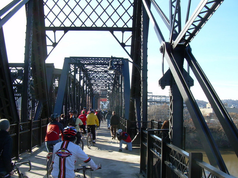 """<a href=""""http://www.flickr.com/photos/kordite/2075210054/sizes/o/in/photostream/"""">Photo Credit</a>  <b>Opening day in November of 2007</b>  The Hot Metal Bridge in Pittsburgh, Pennsylvania was originally built in the 1880s to transport hot steel across the Monongahela River to rolling mills on the other side. This significantly improved business as steel previously had to be reheated. A century later and the bridge is now providing passage over the Monongahela River for bicyclists and pedestrians. A TE fund of over $6,500,000 was matched locally by $730,000 and went towards the removal of lead-based paint, to build a bridge over Second Ave., and to connect the bridge to the Eliza Furnace trail. The bridge reopened in November of 2007 and is a vital connection to the Pittsburgh bicycle network."""