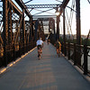 """<a href=""""http://www.flickr.com/photos/pghmtb/3657267804/sizes/l/in/photostream/"""">Photo Credit</a>  The Hot Metal Bridge in Pittsburgh, Pennsylvania was originally built in the 1880s to transport hot steel across the Monongahela River to rolling mills on the other side. This significantly improved business as steel previously had to be reheated. A century later and the bridge is now providing passage over the Monongahela River for bicyclists and pedestrians. A TE fund of over $6,500,000 was matched locally by $730,000 and went towards the removal of lead-based paint, to build a bridge over Second Ave., and to connect the bridge to the Eliza Furnace trail. The bridge reopened in November of 2007 and is a vital connection to the Pittsburgh bicycle network."""