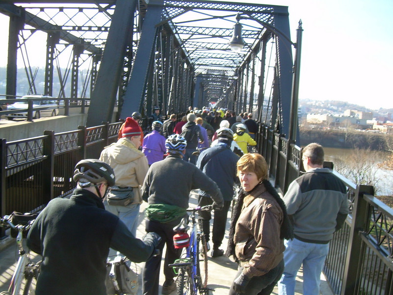 """<a href=""""http://www.flickr.com/photos/kordite/2075210050/sizes/o/in/photostream/"""">Photo Credit</a>  <b>Opening day in November of 2007</b>  The Hot Metal Bridge in Pittsburgh, Pennsylvania was originally built in the 1880s to transport hot steel across the Monongahela River to rolling mills on the other side. This significantly improved business as steel previously had to be reheated. A century later and the bridge is now providing passage over the Monongahela River for bicyclists and pedestrians. A TE fund of over $6,500,000 was matched locally by $730,000 and went towards the removal of lead-based paint, to build a bridge over Second Ave., and to connect the bridge to the Eliza Furnace trail. The bridge reopened in November of 2007 and is a vital connection to the Pittsburgh bicycle network."""