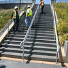 A new staircase provides a direct shortcut from the pedestrian bridge over I-5 to the new plaza.<br /> <br /> The US/Mexico border between San Diego, CA and Tijuana in Mexico is the busiest land border crossing in the world.  Over 30 million vehicles and 18 million pedestrians cross annually, with the border gateway at Interstate 5 suffering significant congestion. Additional delays and safety issues were caused by large numbers of nonmotorized travelers coming into conflict with cars and trucks at the crossing.<br /> <br /> The California Department of Transportation initiated the International Friendship Plaza project to address these issues, and to transform the crossing at Interstate 5 from one more large piece of ugly infrastructure to a human-scale, comfortable, interesting, and clean border crossing experience. The project created a new plaza and promenade on the California side of the crossing, improved circulation through transit and private-vehicle drop-off areas, accessible pathways and turnstiles for disabled travelers, bicycle parking facilities, and formal pedestrian street crossing routes. Public art, historic interpretation, trash receptacles, lighting, and plantings all enhance the experience for travelers passing through the crossing.<br /> <br /> The project was funded in part through $2,246,000 in federal TE funds in 2003. In 2008, the completed project was recognized as outstanding with an Exemplary Human Environment Initiatives (EHEI) award by the Federal Highway Administration.