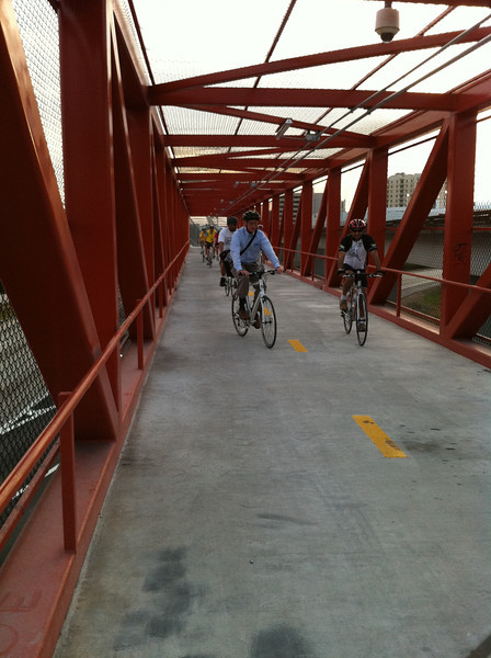 The construction of a bicycle and pedestrian path connecting the Dadeland South and Dadeland North metro stops in Miami, FL began in January of 2011. The project included the construction of a trail, a bicycle and pedestrian bridge over the entrance ramp to SR 878 along SR 5, lighting, signage, and fencing at the two metro stations. In addition to this, new signs and traffic signals were installed at the intersections with pedestrian ramps, intersections were repaved and restriped, and additional landscaping and paving was done.<br />  <br /> The project cost around $4.5 million and was completed in December 2011. The path provides a critical link between two popular Metrorail stations in the Miami-Dade area. The nearby streets are several lanes wide and merge with other major roadways. This path provides a safe and effective way to commute between the two stations and to elsewhere along the M-path.