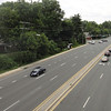 "Veirs Mill Rd. is a high volume road running from Wheaton, MD to Rockville, MD. As a result of this traffic, crossing Veirs Mill Road at Aspen Hill Road was slow and dangerous for pedestrians and bikers on Maryland's <a href=""http://www.montgomeryparks.org/PPSD/ParkTrails/trails_MAPS/rock_creek.shtm""> Rock Creek Hiker-Biker Trail</a>. The intersection at Aspen Hill Road featured an unsignalized crosswalk. In addition this section of trail was incomplete requiring navigation through local streets to continue on the trail. The Rock Creek Trail connects Rockville with Washington, D.C via 22 miles of trails.  To address the safety and congestion concerns in 2004 $3.95 million in TE funds were applied to a project to build a bicycle and pedestrian bridge over Veirs Mill. $5.15 million in local funds were also applied to the project. The construction of the bridge included trail connections to transit and communities, signage, lighting, stormwater management, aesthetics, and stairs. Construction of the project began in 2008 and finished in early 2011.   The project not only facilitates crossing Veirs Mill Road for bicyclists and pedestrians but also helps to reduce congestion for drivers. In 2003 Veirs Mill road had already been identified as having a failing level of service in the A.M. peak and P.M. peak times with congestion only supposed to increase. The existing at-grade crossings were dangerous and inconvenient to pedestrians and motorists alike. The new bridge has created a safe, attractive, and easy way for bicycles, pedestrians, and motorists to travel along or across Veirs Mill road."