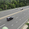 """<b>Traffic on Veirs Mill rd. </b>  Veirs Mill Rd. is a high volume road running from Wheaton, MD to Rockville, MD. As a result of this traffic, crossing Veirs Mill Road at Aspen Hill Road was slow and dangerous for pedestrians and bikers on Maryland's <a href=""""http://www.montgomeryparks.org/PPSD/ParkTrails/trails_MAPS/rock_creek.shtm""""> Rock Creek Hiker-Biker Trail</a>. The intersection at Aspen Hill Road featured an unsignalized crosswalk. In addition this section of trail was incomplete requiring navigation through local streets to continue on the trail. The Rock Creek Trail connects Rockville with Washington, D.C via 22 miles of trails.  To address the safety and congestion concerns in 2004 $3.95 million in TE funds were applied to a project to build a bicycle and pedestrian bridge over Veirs Mill. $5.15 million in local funds were also applied to the project. The construction of the bridge included trail connections to transit and communities, signage, lighting, stormwater management, aesthetics, and stairs. Construction of the project began in 2008 and finished in early 2011.   The project not only facilitates crossing Veirs Mill Road for bicyclists and pedestrians but also helps to reduce congestion for drivers. In 2003 Veirs Mill road had already been identified as having a failing level of service in the A.M. peak and P.M. peak times with congestion only supposed to increase. The existing at-grade crossings were dangerous and inconvenient to pedestrians and motorists alike. The new bridge has created a safe, attractive, and easy way for bicycles, pedestrians, and motorists to travel along or across Veirs Mill road."""