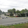 "<b>Intersection of Veirs Mill Rd. and Aspen Hill Rd.</b>  Veirs Mill Rd. is a high volume road running from Wheaton, MD to Rockville, MD. As a result of this traffic, crossing Veirs Mill Road at Aspen Hill Road was slow and dangerous for pedestrians and bikers on Maryland's <a href=""http://www.montgomeryparks.org/PPSD/ParkTrails/trails_MAPS/rock_creek.shtm""> Rock Creek Hiker-Biker Trail</a>. The intersection at Aspen Hill Road featured an unsignalized crosswalk. In addition this section of trail was incomplete requiring navigation through local streets to continue on the trail. The Rock Creek Trail connects Rockville with Washington, D.C via 22 miles of trails.  To address the safety and congestion concerns in 2004 $3.95 million in TE funds were applied to a project to build a bicycle and pedestrian bridge over Veirs Mill. $5.15 million in local funds were also applied to the project. The construction of the bridge included trail connections to transit and communities, signage, lighting, stormwater management, aesthetics, and stairs. Construction of the project began in 2008 and finished in early 2011.   The project not only facilitates crossing Veirs Mill Road for bicyclists and pedestrians but also helps to reduce congestion for drivers. In 2003 Veirs Mill road had already been identified as having a failing level of service in the A.M. peak and P.M. peak times with congestion only supposed to increase. The existing at-grade crossings were dangerous and inconvenient to pedestrians and motorists alike. The new bridge has created a safe, attractive, and easy way for bicycles, pedestrians, and motorists to travel along or across Veirs Mill road."