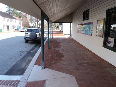 After<br /> <br /> The St. Georges Revitalization Committee sought to use Transportation Enhancements funding to help revitalize the village of North St. George. In 2011, an award of $352,000 was matched with $84,000 in local funds to help address safety concerns, create an identity for the downtown, and construct sidewalks was granted.  The project replaced cracked and deteriorated concrete sidewalks with brick pavers, ADA accessible ramps, and new curbs. In addition, new thermoplastic crosswalks which look like brick were added around Main Street.<br /> <br /> The before and after photos are like night and day. Before, downtown St. George looked distressed and uninviting while afterwards it is warm and welcoming to travelers crossing over the Chesapeake and Delaware Canal on Route 1 or Route 13. Future plans will connect the project area with the C&D Canal path.