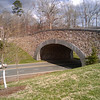 "The Saunders Bridge is a stone arch bridge that crosses Route 53. It was designed by a local firm, Rieley and Associates, and is said to be the realization of one of Thomas Jefferson's plans for the development of his property.  The Thomas Jefferson Parkway (Route 53), part of the <a href=""http://www.byways.org/explore/byways/2343/directions.html"">Journey Through Hallowed Ground Byway</a>, serves as the scenic entrance to Monticello in Albermarle County, Virginia.  Developed by the Thomas Jefferson Foundation, the Parkway improvement project was a $6.5 million project that took place between 1996 and 2002 and involved the development of the <a href=""http://www.monticello.org/parkway/trail.html""> Saunders-Monticello Trail</a>, an <a href=""http://www.monticello.org/parkway/arboretum.html"">arboretum</a>, a 2-acre <a href=""http://www.monticello.org/parkway/pond.html"">pond</a>, and the <a href=""http://www.monticello.org/parkway/bridge.html"">Saunders Bridge</a>.  A $3.4 million TE grant, procured in 1992, along with private donations in the amount of $3.1 million provided funding for the Thomas Jefferson Parkway improvements."