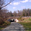 "The Saunders-Monticello Trail is a 2-mile, ADA accessible, bike and pedestrian trail that provides visitors of Monticello a safe alternative to Route 53, which lacks bike and pedestrian facilities. It is also wildly popular among community residents who use it for recreation and fitness opportunities. The trail terminates at the <a href=""http://www.monticello.org/featured/new_vc.html"">Thomas Jefferson Visitor Center and Smith History Center</a>.  The Thomas Jefferson Parkway (Route 53), part of the <a href=""http://www.byways.org/explore/byways/2343/directions.html"">Journey Through Hallowed Ground Byway</a>, serves as the scenic entrance to Monticello in Albermarle County, Virginia.  Developed by the Thomas Jefferson Foundation, the Parkway improvement project was a $6.5 million project that took place between 1996 and 2002 and involved the development of the <a href=""http://www.monticello.org/parkway/trail.html""> Saunders-Monticello Trail</a>, an <a href=""http://www.monticello.org/parkway/arboretum.html"">arboretum</a>, a 2-acre <a href=""http://www.monticello.org/parkway/pond.html"">pond</a>, and the <a href=""http://www.monticello.org/parkway/bridge.html"">Saunders Bridge</a>.  A $3.4 million TE grant, procured in 1992, along with private donations in the amount of $3.1 million provided funding for the Thomas Jefferson Parkway improvements."