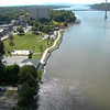 "Photo Credit: Daniel Tobias  The <a href=""http://nysparks.state.ny.us/parks/178/details.aspx""> Walkway Over the Hudson State Historic Park<a/> opened to the public in October of 2009. The walkway rests on the former Poughkeepsie-Highland Railroad Bridge which provided passage for freight and passenger trains between New York City and New England. The bridge was in service for nearly a century until a 1974 fire severely damaged the bridge. After the fire the bridge was out of service for decades.   In 1998 <a href=""http://walkway.org/""> Walkway Over the Hudson<a/>--a non-profit with the mission of connecting people to the Hudson Valley through stewardship of the State Historic Park--assumed ownership and began efforts to revitalize the bridge. In May of 2008 construction began. After the park opened an American Recovery and Reinvestment Act project was funded with $2.4 million through the TE program. The ARRA project aimed to increase access between the bridge and the waterfront and streets of Poughkeepsie, enhance multi-modal access between the walkway and the Poughkeepsie train station, and increase parking and facilities for persons with disabilities. The project will include a 21-story elevator, pathways along the waterfront and to the train station, and stair access on the eastside of the bridge.     The bridge has proven to be widely popular in its first year in providing people with a great place to walk, bike, rollerblade, or jog. With connections to the Dutchess County Rail Trail and Hudson Valley Rail Trail, the bridge makes it easier for local citizens and tourists to travel around the Hudson Valley. The trail has proven very popular, and actual use of the bridge is nearly 3 times higher than anticipated."