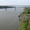 "Photo Credit: Kathryn Jones  The <a href=""http://nysparks.state.ny.us/parks/178/details.aspx""> Walkway Over the Hudson State Historic Park<a/> opened to the public in October of 2009. The walkway rests on the former Poughkeepsie-Highland Railroad Bridge which provided passage for freight and passenger trains between New York City and New England. The bridge was in service for nearly a century until a 1974 fire severely damaged the bridge. After the fire the bridge was out of service for decades.   In 1998 <a href=""http://walkway.org/""> Walkway Over the Hudson<a/>--a non-profit with the mission of connecting people to the Hudson Valley through stewardship of the State Historic Park--assumed ownership and began efforts to revitalize the bridge. In May of 2008 construction began. After the park opened an American Recovery and Reinvestment Act project was funded with $2.4 million through the TE program. The ARRA project aimed to increase access between the bridge and the waterfront and streets of Poughkeepsie, enhance multi-modal access between the walkway and the Poughkeepsie train station, and increase parking and facilities for persons with disabilities. The project will include a 21-story elevator, pathways along the waterfront and to the train station, and stair access on the eastside of the bridge.     The bridge has proven to be widely popular in its first year in providing people with a great place to walk, bike, rollerblade, or jog. With connections to the Dutchess County Rail Trail and Hudson Valley Rail Trail, the bridge makes it easier for local citizens and tourists to travel around the Hudson Valley. The trail has proven very popular, and actual use of the bridge is nearly 3 times higher than anticipated."