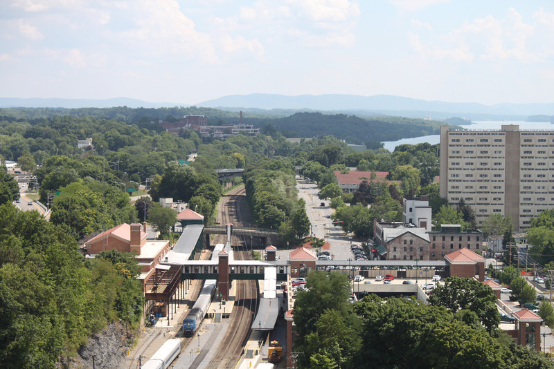 "Photo Credit: Joseph A  <b>Poughkeepsie Train Station</b>  The <a href=""http://nysparks.state.ny.us/parks/178/details.aspx""> Walkway Over the Hudson State Historic Park<a/> opened to the public in October of 2009. The walkway rests on the former Poughkeepsie-Highland Railroad Bridge which provided passage for freight and passenger trains between New York City and New England. The bridge was in service for nearly a century until a 1974 fire severely damaged the bridge. After the fire the bridge was out of service for decades.   In 1998 <a href=""http://walkway.org/""> Walkway Over the Hudson<a/>--a non-profit with the mission of connecting people to the Hudson Valley through stewardship of the State Historic Park--assumed ownership and began efforts to revitalize the bridge. In May of 2008 construction began. After the park opened an American Recovery and Reinvestment Act project was funded with $2.4 million through the TE program. The ARRA project aimed to increase access between the bridge and the waterfront and streets of Poughkeepsie, enhance multi-modal access between the walkway and the Poughkeepsie train station, and increase parking and facilities for persons with disabilities. The project will include a 21-story elevator, pathways along the waterfront and to the train station, and stair access on the eastside of the bridge.     The bridge has proven to be widely popular in its first year in providing people with a great place to walk, bike, rollerblade, or jog. With connections to the Dutchess County Rail Trail and Hudson Valley Rail Trail, the bridge makes it easier for local citizens and tourists to travel around the Hudson Valley. The trail has proven very popular, and actual use of the bridge is nearly 3 times higher than anticipated."