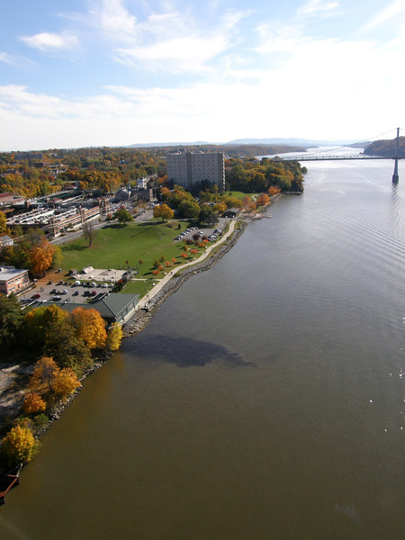 """Photo Credit: Melissa M.  <b>A view of the path along the waterfront</b>  The <a href=""""http://nysparks.state.ny.us/parks/178/details.aspx""""> Walkway Over the Hudson State Historic Park<a/> opened to the public in October of 2009. The walkway rests on the former Poughkeepsie-Highland Railroad Bridge which provided passage for freight and passenger trains between New York City and New England. The bridge was in service for nearly a century until a 1974 fire severely damaged the bridge. After the fire the bridge was out of service for decades.   In 1998 <a href=""""http://walkway.org/""""> Walkway Over the Hudson<a/>--a non-profit with the mission of connecting people to the Hudson Valley through stewardship of the State Historic Park--assumed ownership and began efforts to revitalize the bridge. In May of 2008 construction began. After the park opened an American Recovery and Reinvestment Act project was funded with $2.4 million through the TE program. The ARRA project aimed to increase access between the bridge and the waterfront and streets of Poughkeepsie, enhance multi-modal access between the walkway and the Poughkeepsie train station, and increase parking and facilities for persons with disabilities. The project will include a 21-story elevator, pathways along the waterfront and to the train station, and stair access on the eastside of the bridge.     The bridge has proven to be widely popular in its first year in providing people with a great place to walk, bike, rollerblade, or jog. With connections to the Dutchess County Rail Trail and Hudson Valley Rail Trail, the bridge makes it easier for local citizens and tourists to travel around the Hudson Valley. The trail has proven very popular, and actual use of the bridge is nearly 3 times higher than anticipated."""