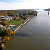 "Photo Credit: Melissa M.  <b>A view of the path along the waterfront</b>  The <a href=""http://nysparks.state.ny.us/parks/178/details.aspx""> Walkway Over the Hudson State Historic Park<a/> opened to the public in October of 2009. The walkway rests on the former Poughkeepsie-Highland Railroad Bridge which provided passage for freight and passenger trains between New York City and New England. The bridge was in service for nearly a century until a 1974 fire severely damaged the bridge. After the fire the bridge was out of service for decades.   In 1998 <a href=""http://walkway.org/""> Walkway Over the Hudson<a/>--a non-profit with the mission of connecting people to the Hudson Valley through stewardship of the State Historic Park--assumed ownership and began efforts to revitalize the bridge. In May of 2008 construction began. After the park opened an American Recovery and Reinvestment Act project was funded with $2.4 million through the TE program. The ARRA project aimed to increase access between the bridge and the waterfront and streets of Poughkeepsie, enhance multi-modal access between the walkway and the Poughkeepsie train station, and increase parking and facilities for persons with disabilities. The project will include a 21-story elevator, pathways along the waterfront and to the train station, and stair access on the eastside of the bridge.     The bridge has proven to be widely popular in its first year in providing people with a great place to walk, bike, rollerblade, or jog. With connections to the Dutchess County Rail Trail and Hudson Valley Rail Trail, the bridge makes it easier for local citizens and tourists to travel around the Hudson Valley. The trail has proven very popular, and actual use of the bridge is nearly 3 times higher than anticipated."